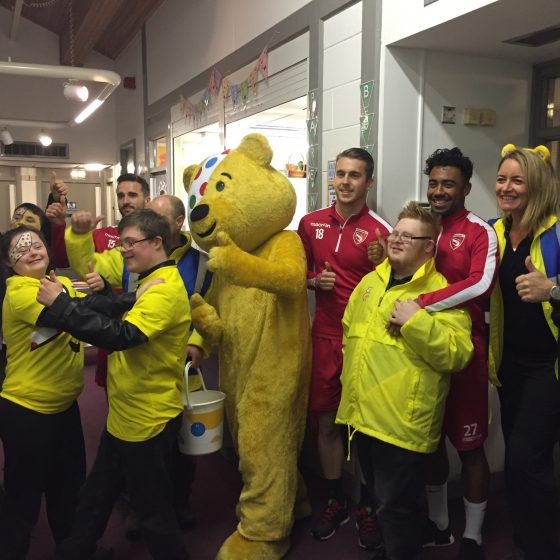 Pudsey with children from Unique Kidz and Co and footballers from Morecambe Football Club