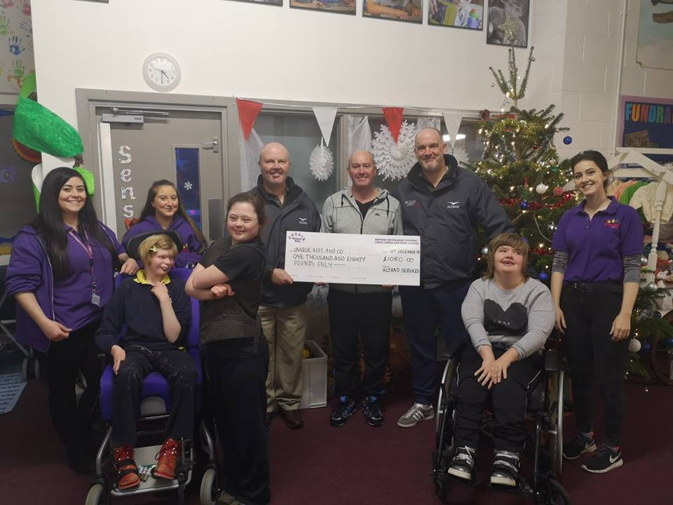 Staff from Altrad Services present Unique KIdz and Co with cheque