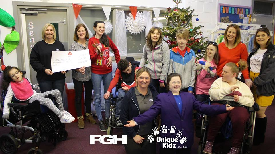 Staff from FGH present Unique Kidz and Co with cheque